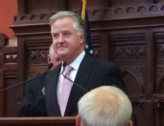 J. Brendan Sharkey listens to tributes from House colleagues praising his service as speaker.