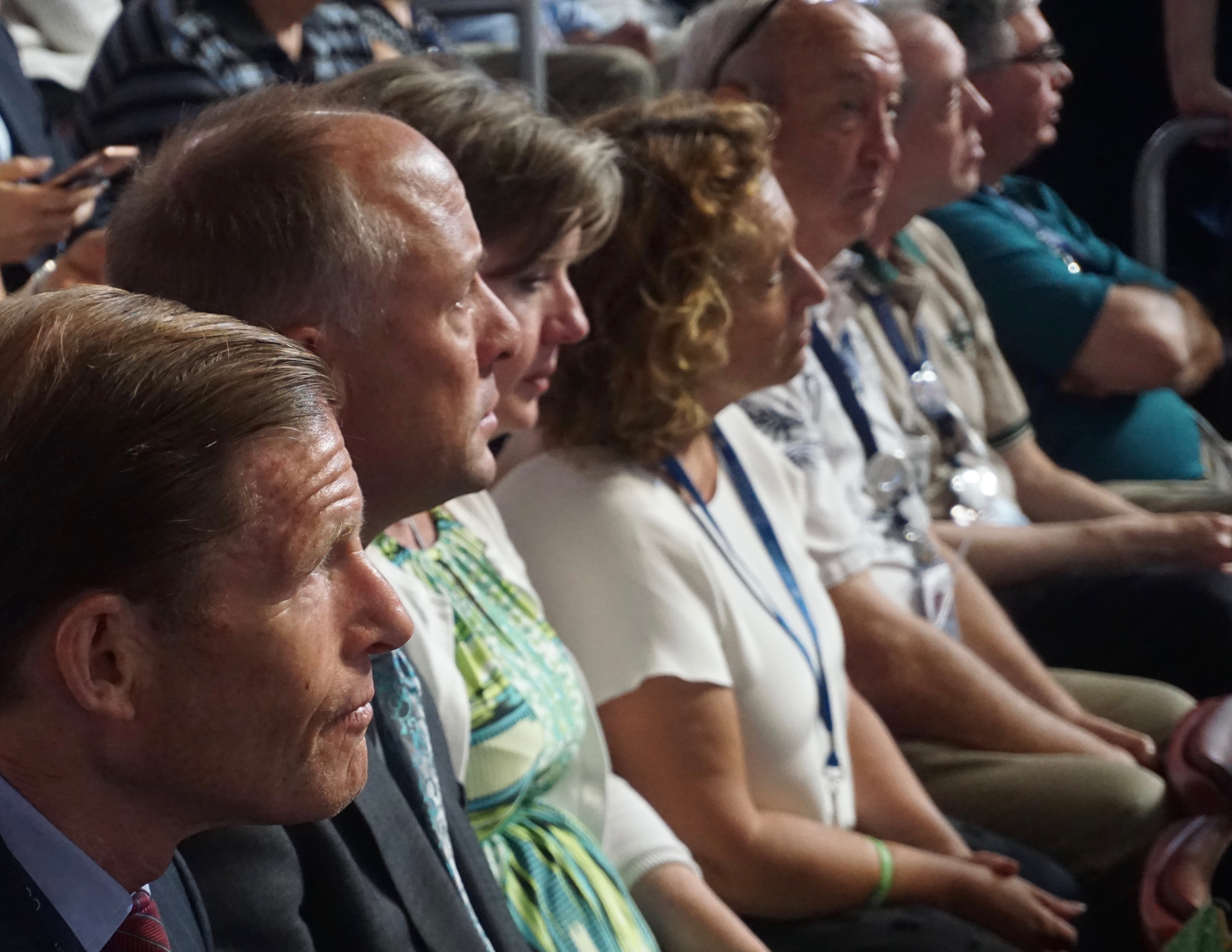 """Watching Sen. Chris Murphy's speech are, left to right, Sen. Richard Blumenthal; Mark and Jackie Barden, whose 7-year-old son Daniel was killed at Sandy Hook; and documentarian Kim Snyder, whose film """"Newtown"""" on the Sandy Hook massacre was screened in Philadelphia Wednesday."""