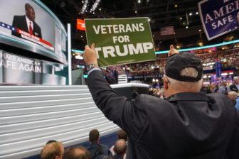 Charles Bruckerhoff of Chaplin, a Vietnam vet, waves a sign.