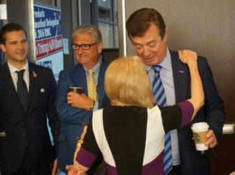 Trump's campaign manager, Paul Manafort is greeted by a delegate during his visit to the Connecticut delegation breakfast. Laurie Gay, who runs a Trump superPAC, is at left. Read the story here.