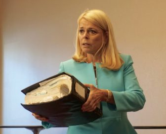 Betsy McCaughey and her copy of Obamacare.