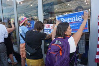 Kate Larson, a Sanders delegate from Iowa, protesting the media,