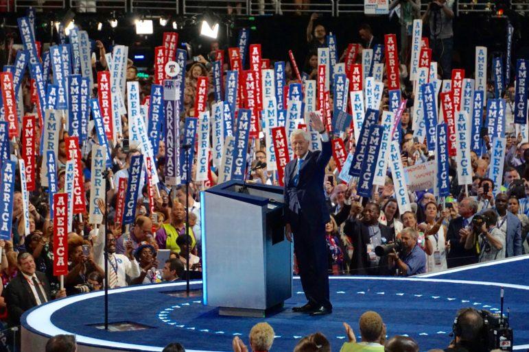 Bill Clinton makes an entrance.