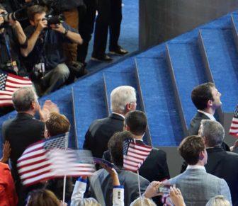 The photographers and Bill Clinton focused on Hillary Clinton.
