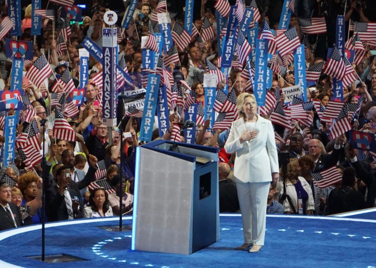 Hillary Clinton acknowledges sustained applause as she accepts the nomination to be president.