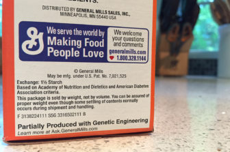 A GMO notice on the side of a box of Wheaties.