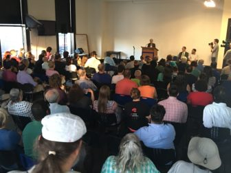 About 150 people listen as Green Party presidential candidate Jill Stein holds a rally in Stamford.