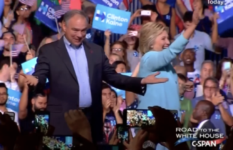 Virginia Sen. Tim Caine on stage with Hillary Clinton for the announcement of his selection as her vice presidential running mate.