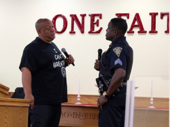 Connecticut NAACP President Scot X. Esdaile and New Haven Police Sgt. Shafiq Abdussabar engage in dialogue during a police-community forum in New Haven on July 22. This is one of several such forums that have taken place across Connecticut in the wake of police shootings and the killing of unarmed black men.