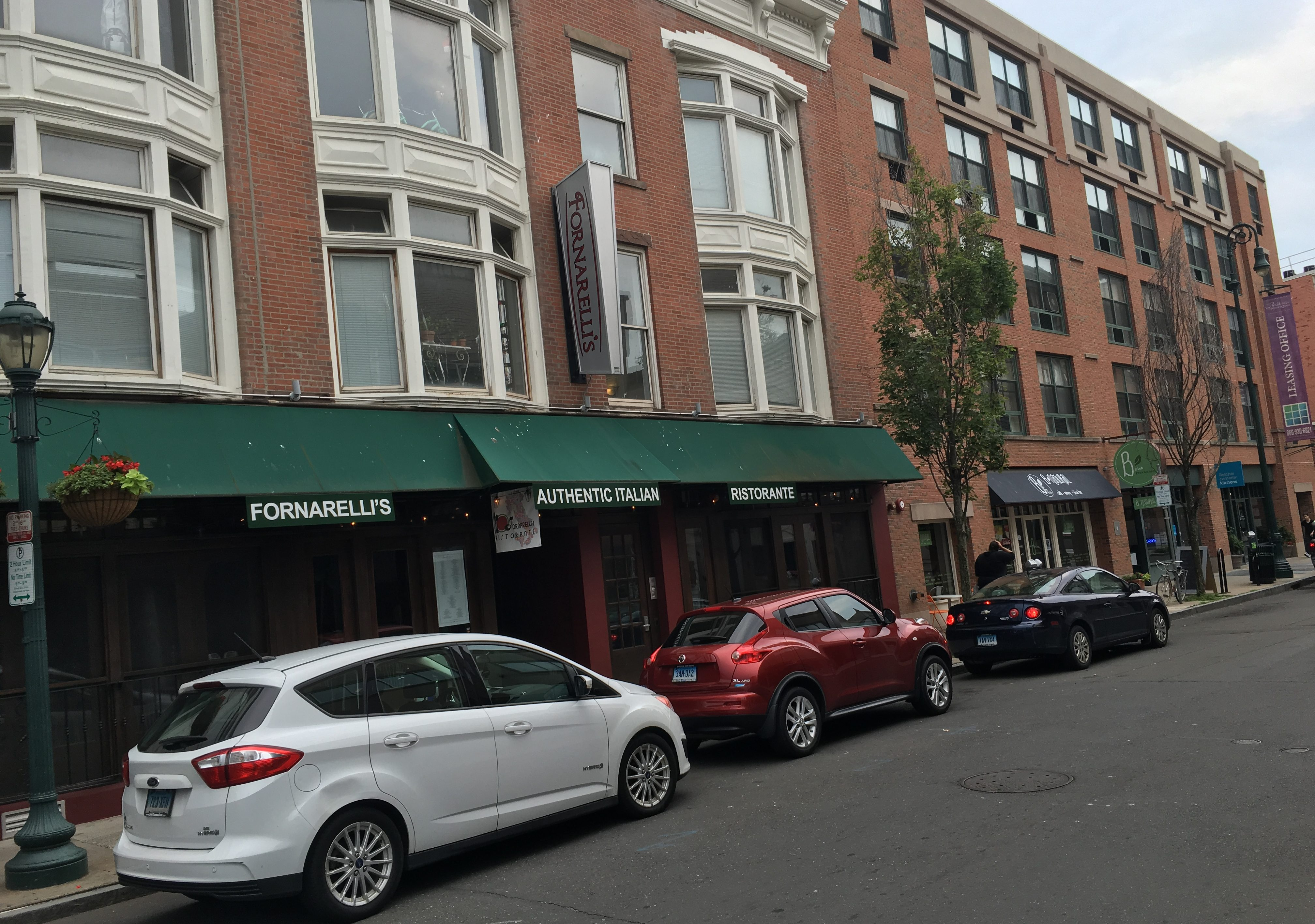 A blend of new and old buildings in a Ninth Square streetscape.