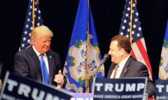 Donald Trump invites Rep. Tony D'Amelio, R-Waterbury, onto the stage during an April rally at Crosby High School in Waterbury. D'Amelio will be a delegate to the GOP convention.