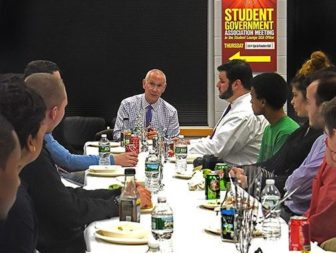 CSCU President Mark Ojakian, meets with students at Tunxis Community College earlier this year.