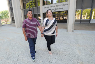 Lead plaintiff Jose Martinez and his mother Jessica Martinez outside U.S. District Court in Bridgeport