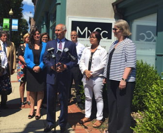 CSCU President Mark Ojakian, flanked by legislators and other college leaders, announces the Meriden campus of Middlesex Community College will stay open