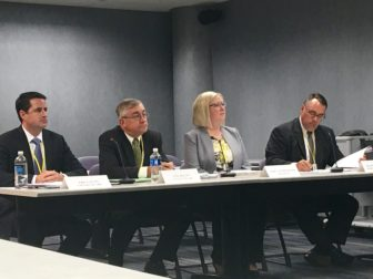 ConnectiCare officials listen during a public hearing on their proposed rate increases Thursday.