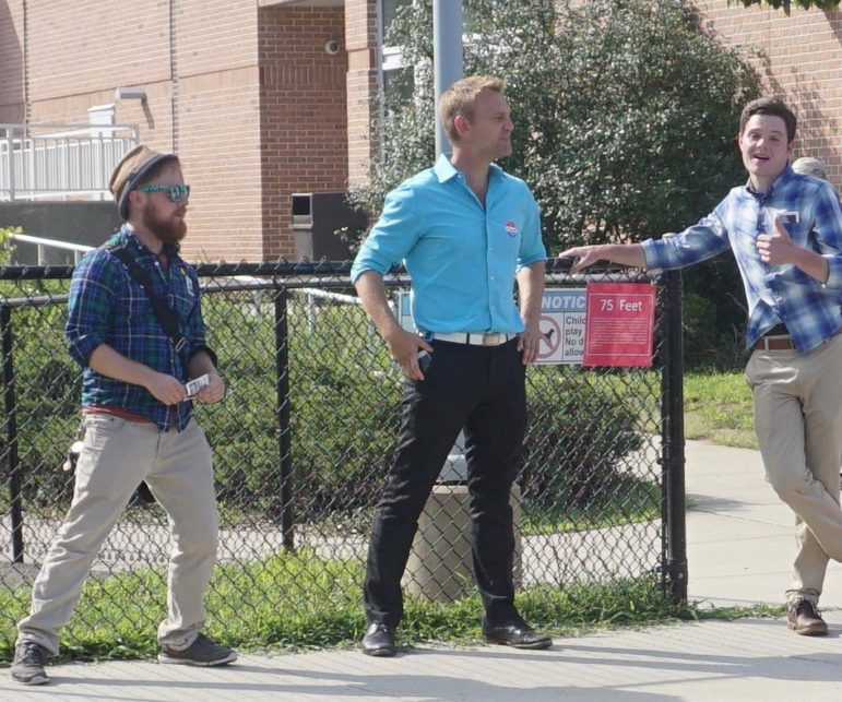 Joshua Elliott, center, at the polls. At left is a Working Families field worker.