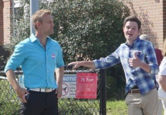 Joshua Elliott, left, poll standing with a supporter who saw him winning.