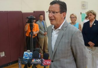Gov. Dannel P. Malloy talks to the press Monday.
