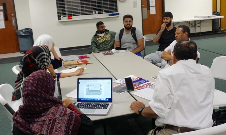Mansoor leading a planning session for a conference on Muslim political activism.