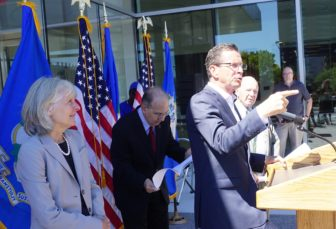 Malloy makes a point. At left is Catherine Smith and Sen. Martin M. Looney.