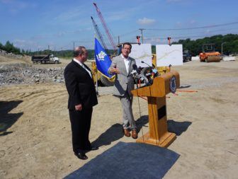 Malloy and Waterbury Mayor Neil O'Leary, standing on what will be part of I-84 in 2019.