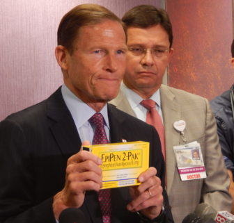 U.S. Sen. Richard Blumenthal holds an EpiPen two-pak box during a press conference in Hartford Wednesday.