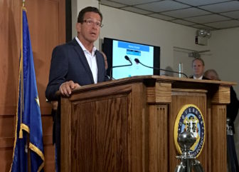Gov. Dannel P. Malloy answers questions from reporters at the State Armory Tuesday morning.