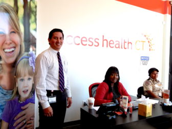 Staff at the Access Health CT enrollment center in New Britain preparing for the open enrollment that ended in January.