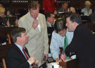 Ward, seated at left, strategizes during a House session.