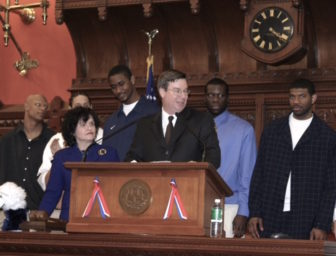 Ward at the House podium with Moira Lyons at left