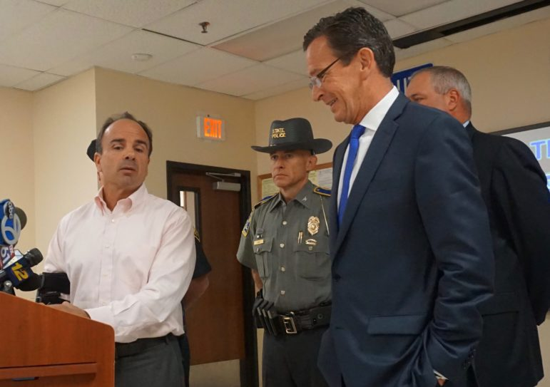 The mood was easier after the meeting as Ganim thanked Malloy. At center is Col. Alaric Fox .