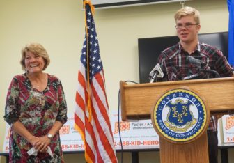Kathy Coale laughs as her nephew, Avery, thanks their DCF social worker, Adam Texeira.