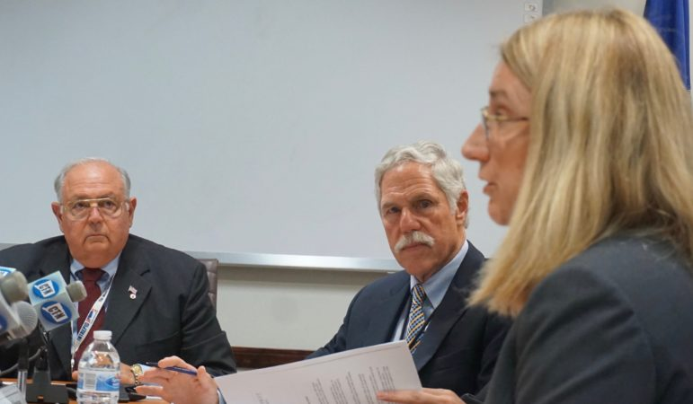 Ethics board members Charles F. Chicano and Kevin Johnston listen to Kimberly Knox, lawyer for Katharine L. Wade.