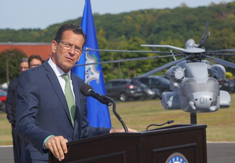 Gov. Dannel P. Malloy and a model of the CH-53K King Stallion.