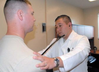 Capt. David Kassop, 22d Chemical Battalion physician, listens to the heartbeat of a patient at the Edgewood Troop Medical Clinic at Aberdeen Proving Ground Sept 13. Photo by Chanel Weaver
