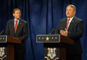 Blumenthal listens as Carter jabs.