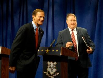 Blumenthal, Carter look to the small studio audience as the debate ends.