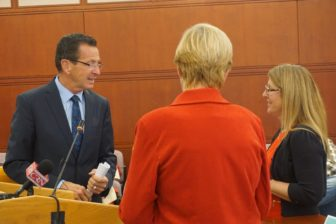 Gov. Dannel P. Malloy with Sen. Cathy Osten, back to camera, and Allison Quirion, the founder of the Connecticut chapter of the advocacy group, Decoding Dyslexia.