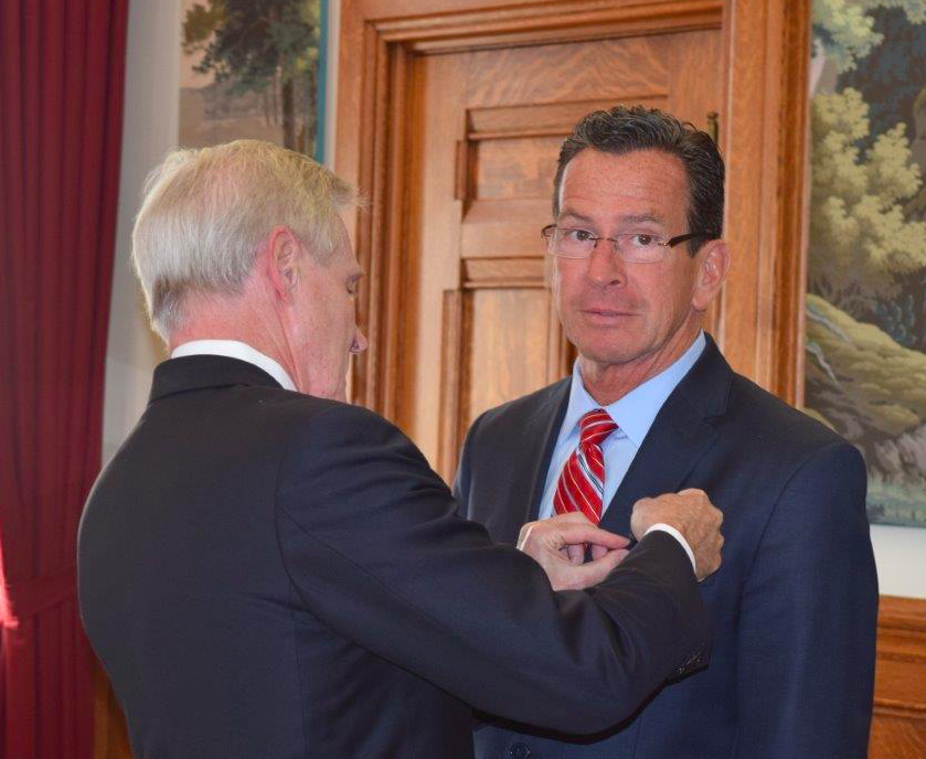 Navy Secretary Mabus drops in with a medal for Malloy