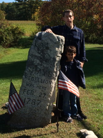 The writer and his son at the site of the final battle of Shays' Rebellion in Massachusetts.