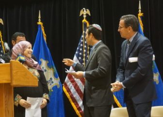 Rabbi Joshua Ratner and Gov. Dannel P. Malloy greet Abir, a Syrian refugee.