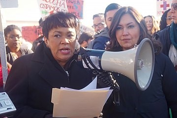 Harp affirming New Haven's pro-immigrant policies at a January rally against planned federal raids.