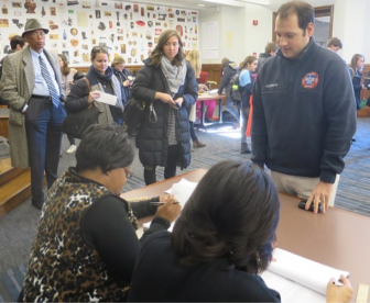 Myles Alderman reaches the checkers after two hours and 20 minutes in line to vote at New Haven's Hall of Records.