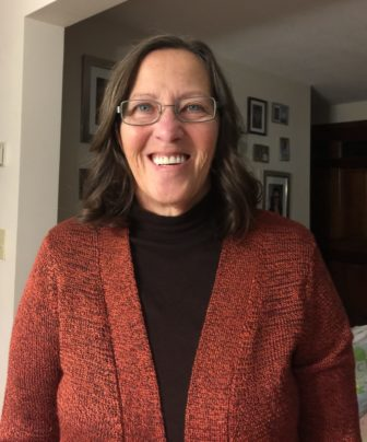 Cindy Jalbert: Without knowing whether she will be able to buy insurance with a pre-existing condition, her husband is putting off plans to retire.