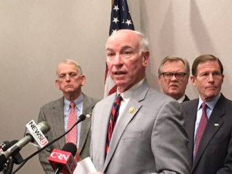 U.S. Rep. Joe Courtney voices objections to realignment of the shoreline rail route. Left to right, behind Courtney are Stonington First Selectman Rob Simmons, State Sen. Paul Formica and U.S. Sen. Richard Blumenthal.
