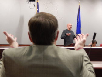 Representative-elect David Wilson participates in a grounding exercise led by Deron Drumm, executive director of Advocacy Unlimited, during a mental health training at the state Capitol Complex