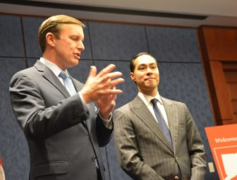Sen. Chris Murphy, left, and Julian Castro, secretary of the Department of Housing and Urban Development.