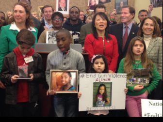 Relatives of victims of gun violence at a Washington, D.C., press conference Thursday. Joining them were members of the Connecticut congressional delegation, including Rep. Elizabeth Esty, D-5th District, at left, and Sens. Chris Murphy and Richard Blumenthal, at rear.