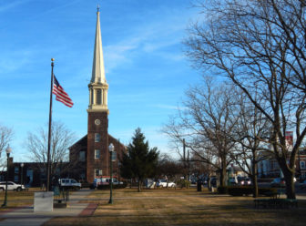 The Old Stone Church stands over the East Haven town green on a windy weekday in January.