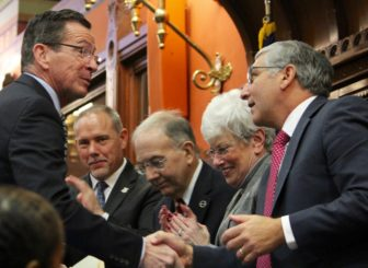 Gov. Dannel P. Malloy, left, shakes hands with State Senate Republican Leader Len Fasano. With them, for left are new House speaker joe Aresimowicz, Senate President Pro Tem Martin Looney and Lt. Gov. Nancy Wyman.